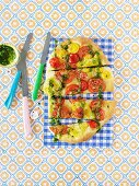 Tomato pizza with mint pesto