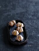 Espresso macaroons filled with caramel