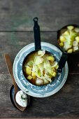 White cabbage and potato stew with parsley cream