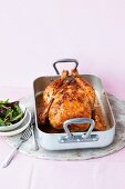 Spicy roast chicken in a roasting tin
