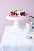 Blackberry cheesecake on a cake stand