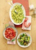 Orecchiette al pesto with a tomato salad and a broccoli medley