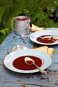 Cold rose hip soup on a table outside