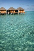 Dhigufinolhu bungalows in water at dock in Maldives island