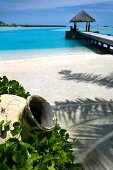View of jetty with blue sea near Veligandu Huraa resort, Maldives