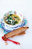 Spinach soup with fennel, feta and pine nuts
