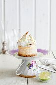A mini cheesecake topped with meringue on a saucer