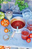 Tomato chutney with vanilla being made