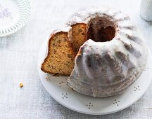 Walnut and orange cake with icing sugar