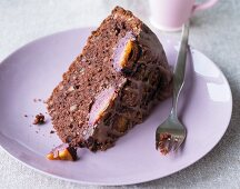 A slice of chocolate cake with plums