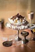 Chocolate Pavlova with passion fruit sauce