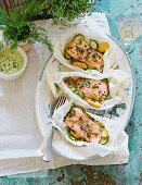 Salmon fillet with courgettes and herbs in parchment paper