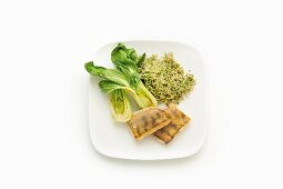 Zander with green vegetable rice, bok choy and moringa powder