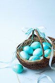 A basket of turquoise Easter eggs