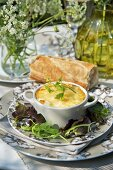 Baked egg with leek and a baguette