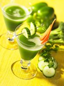 Green vegetable juice garnished with cucumber and carrots