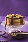 Slices of German layer cake on a cake stand