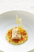 Poached sturgeon fillet with fennel and tomato vinaigrette