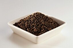 Pu Erh Loose Tea in a White Dish; White Background