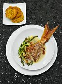 Oriental style snapper and lentil cakes