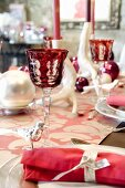 A table laid for Christmas dinner decorated in pink