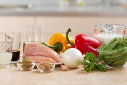 Ingredients for chicken curry (chicken breast, vegetables and spices)