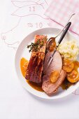 Smoked pork chop with apricot sauce and mashed potatoes