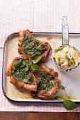 Pork chops with pesto and tagliatelle