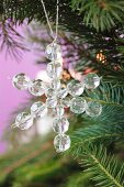 A star made of glass beads hanging on the Christmas tree
