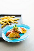 Curried horse sausage with chips