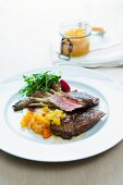 Foal steaks with orange and pineapple chutney