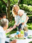 A family having coffee in a garden