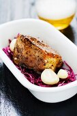 Roast pork with garlic, red cabbage and beer