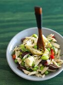 Orzo Salad with Artichoke Hearts, Olives and Peas; Wooden Spoon