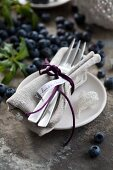Place setting with blueberries (cultured blueberry variety 'Hardyblue')