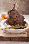 Costata di manzo (steamed rib-eye steak on a bed of vegetables, Italy)