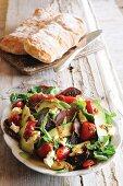 Avocado salad with biltong, pepper and feta cheese