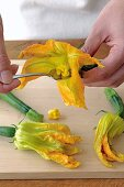 Stigma being removed from courgette flowers