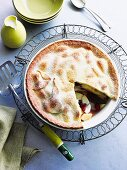 An autumnal pies filled with apples, pears, quinces and cranberries