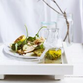 Chicken salad with potatoes, capers and green sauce