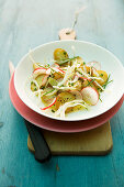 Fried potato salad with radishes, cucumbers and onions
