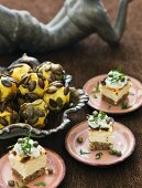 Potato balls and canapes with cheese and caper cream