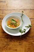 Potato soup with herbs and carrots