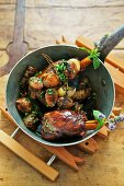 Braised leg of lamb with Jerusalem artichokes and herbs