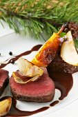 Roast saddle of venison with braised pears