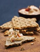 Crisp bread with cream cheese, sun-dried tomatoes and chipotle chillies