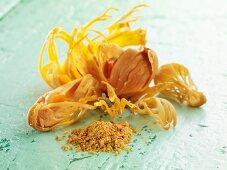 Dried nutmeg flowers and nutmeg powder