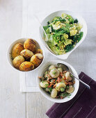 A savoy cabbage medley with nuts, white turnips with diced bacon and fanned potatoes
