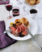 Roasted rib-eye steak with Yorkshire puddings and gravy (England)