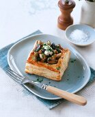 Puff pastry tartlet with mixed mushrooms and bacon